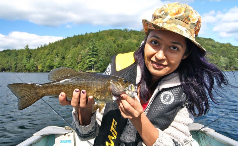Smallmouth bass fishing wearing Sombriolet Sun Hat